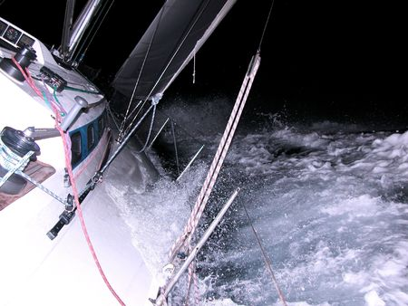 Sailing at night Stock Photo