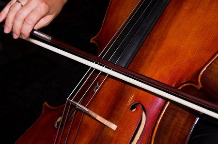 a cello being played by feminine hands Stock Photo