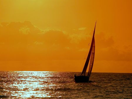 Sailing To The Sunset Stock Photo