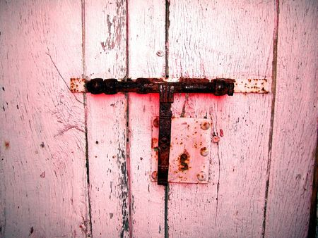An old and decorative white latch photo