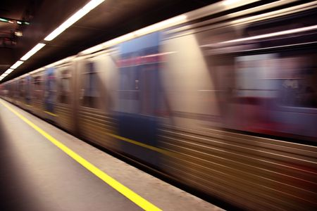 An abstract subway train blured in motion