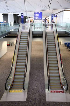 detail of an escalator in Hong Kong aeroport photo