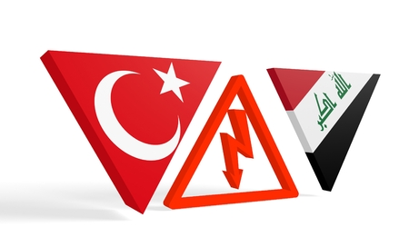 area of conflict: Image relative to politic relationships between Iraq and Turkey. National flags on triangles banner divided by high voltage sign