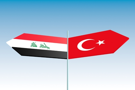 politic: Image relative to politic relationships between Iraq and Turkey. National flags on destination arrow road sign