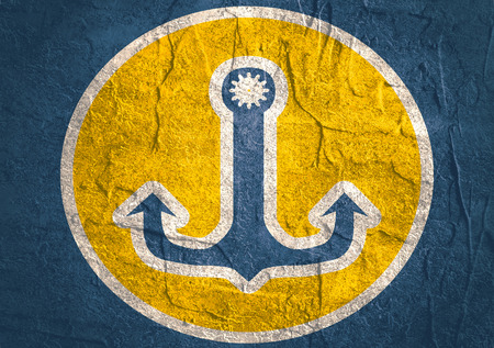 travel industry: Sea travel, industry and journey sticker icon. Blue and yellow colors. Anchor with gear hole. Concrete textured surface