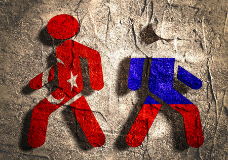 area of conflict: Image relative to politic relationships between Russia and Turkey. National flags on human icons. Concrete textured surface.