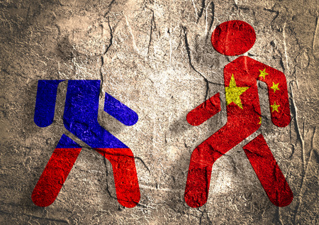 area of conflict: Image relative to politic relationships between Russia and China. National flags on human icons. Concrete textured surface. Stock Photo