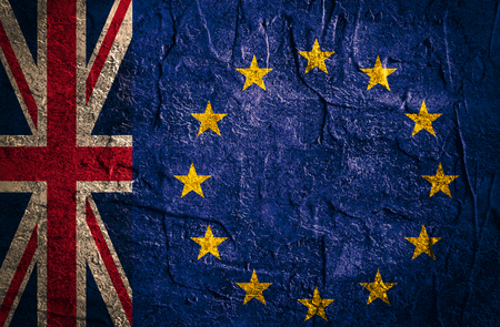 area of conflict: Image relative to politic relationships between Europe Union and United Kingdom. National flags on concrete textured backdrop. Brexit theme