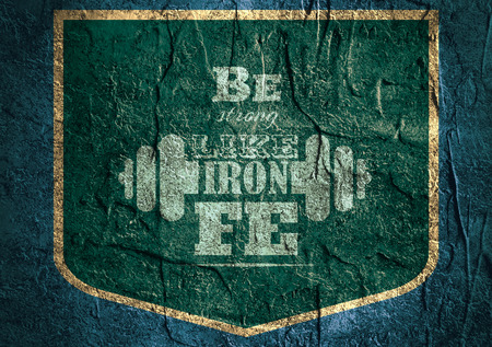 body building: Be strong like iron. Gym and Fitness Motivation Quote. Creative  Typography Emblem Concept. Letters and dumbbell icons. Body building relative. Shield on concrete textured surface