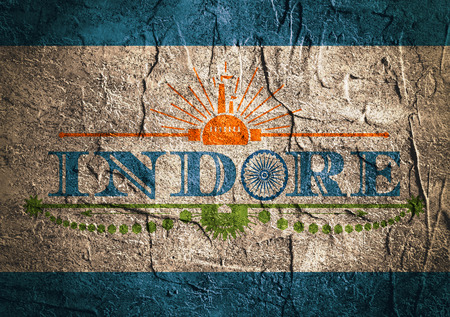 indore: Image relative to India industry. Indore city name with flag colors styled letter O. Urban industrial cluster. Vintage elements. Concrete wall textured surface