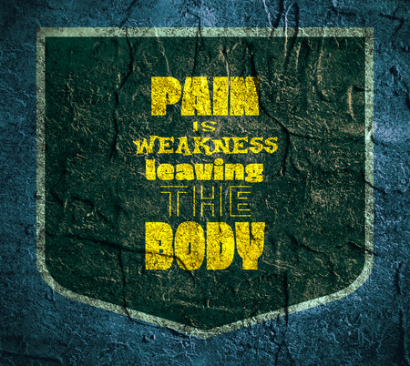 weakness: Pain is weakness leaving the body. Gym and Fitness Motivation Quote. Creative Vector Typography Poster Concept. Letters on dark shield emblem. Body building relative. Concrete wall textured surface