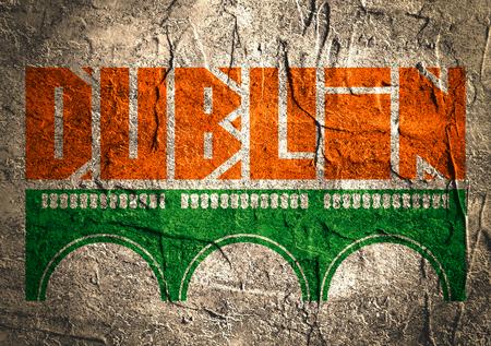 irish landscape: Dublin city name and bridge silhouette. Concrete textured