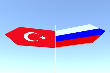politic: Image relative to politic relationships between Russia and Turkey. National flags on road arrow sign