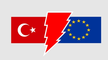 high voltage sign: Image relative to politic relationships between European Union  and Turkey. National flags divided by high voltage sign