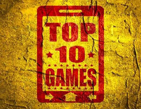 top ten: Top ten games text on phone screen.  Abstract touchscreen with lettering. Concrete textured