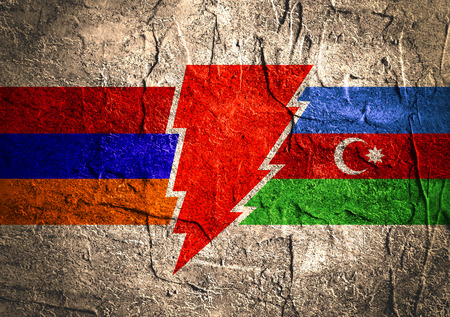 politic: Image relative to politic relationships between Armenia and Azerbaijan. National flags on triangles banner divided by high voltage sign. Concrete textured Stock Photo