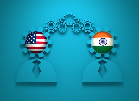 usa flags: Image relative to politic and economic relationship between USA and India. National flags in gears head of the businesman. Teamwork concept Stock Photo