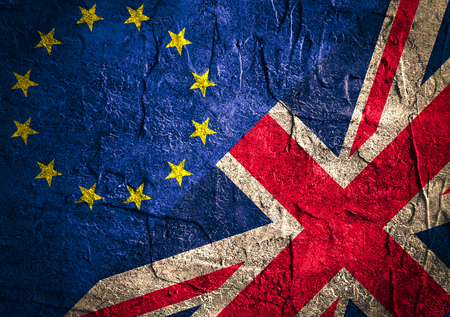politic: Image relative to politic relationships between Europe Union and United Kingdom. National flags on concrete textured backdrop. Brexit theme