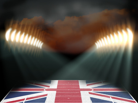 french board: Football stadium with United Kingdom flag textured field. Night scene