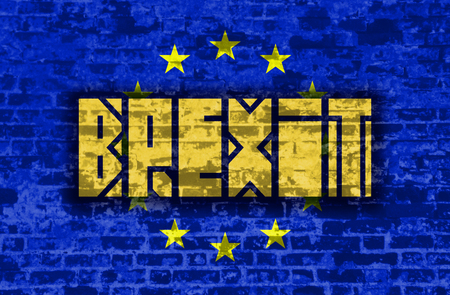 area of conflict: Brexit text on European Union flag backdrop textured by brick wall