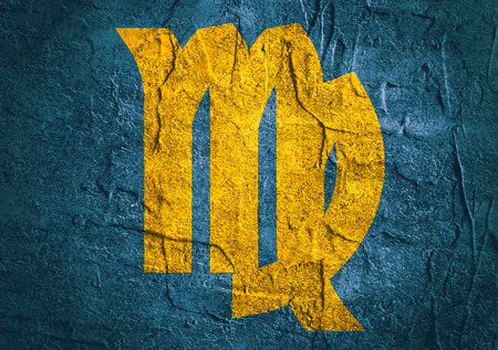 augury: Maiden astrology sign. Yellow astrological symbol on concrete textured backdrop