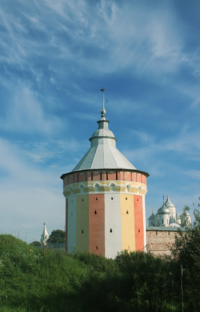 watch city: Watch tower of Spaso-Prilutsky Monastery in the Vologda city, Russia. Blue sky and green grass. Stock Photo