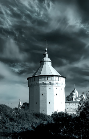 watch city: Watch tower of Spaso-Prilutsky Monastery in the Vologda city, Russia. Dramatic view. Monochrome image. Castle defense wall