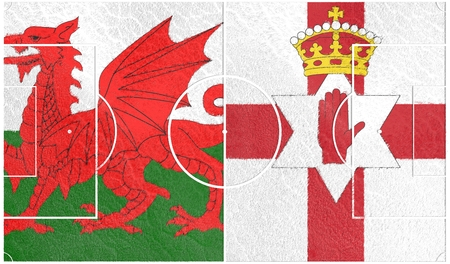 nothern ireland: Football field textured by Wales and Nothern Ireland national flags.3D rendering Stock Photo