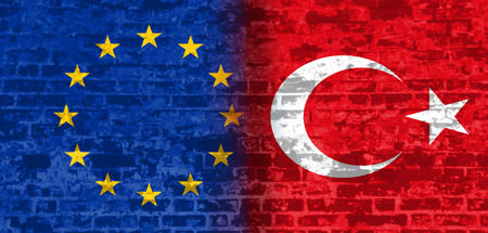 politic: Image relative to politic relationships between European Union and Turkey. National flags textured by brick wall.