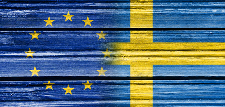 politic: Image relative to politic relationships between European Union and Sweden. National flags textured by wood Stock Photo