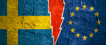 high voltage sign: Image relative to politic relationships between European Union and Sweden. National flags divided by high voltage sign. Concrete textured