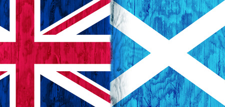 area of conflict: Image relative to politic relationships between United Kingdom and Scotland. National flags textured by wood