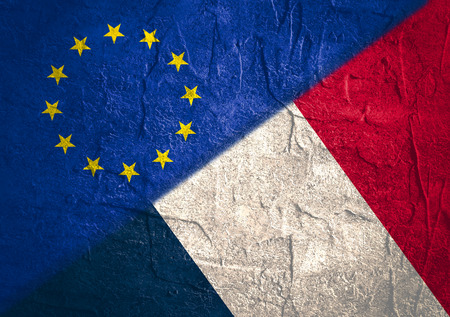 area of conflict: Image relative to politic relationships between European Union and France. National flags textured by concrete