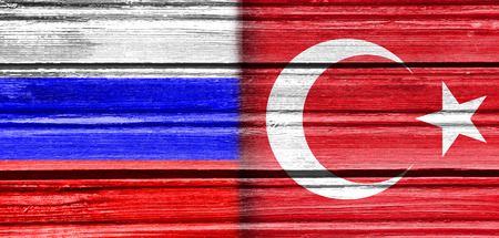 politic: Image relative to politic relationships between European Union and Turkey. National flags textured by wood.