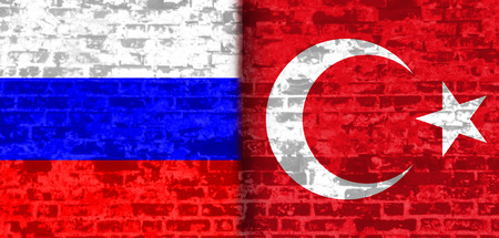 area of conflict: Image relative to politic relationships between Russia and Turkey. National flags textured by brick wall. Stock Photo
