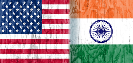 politic: Image relative to politic relationships between United States and India. National flags textured by wood Stock Photo