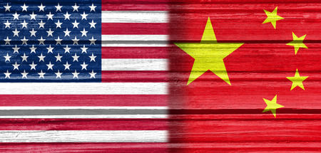 politic: Image relative to politic relationships between United States and China. National flags textured by wood