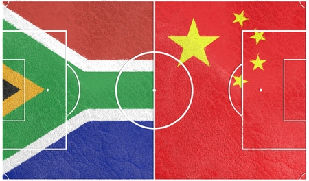 qualification: Flags of countries participating to the football tournament. Football field textured by South Africa and China national flags. 3D rendering Stock Photo