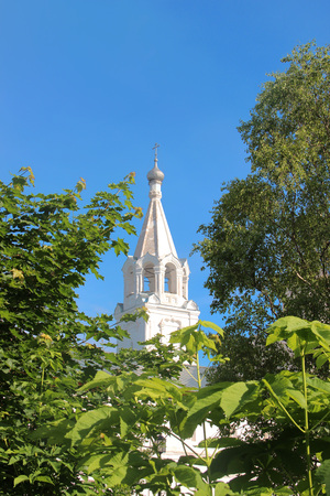 Watch tower of Spaso-Prilutsky Monastery in the Vologda city, Russia. Bell tower of the church among green trees Stock Photo
