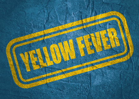 Stamp with Yellow Fever text over concrete textured background. Medical science relative theme Stock Photo