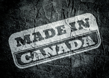 canada stamp: Stamp with made in Canada text over concrete textured background