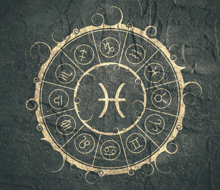 augury: Astrological symbols in the circle. Concrete wall textured. Fish sign Stock Photo