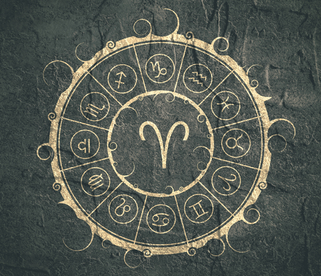 augury: Astrological symbols in the circle. Concrete wall textured. Ram sign