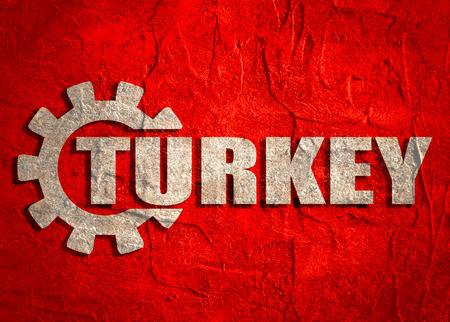 Turkey word build in gear. Heavy industry relative image. Grunge textured backdrop.