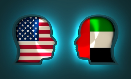 Image relative to politic and economic relationship between USA and United Arab Emirates. National flags inside the heads of the businessmen. Teamwork concept. 3D rendering. Neon light