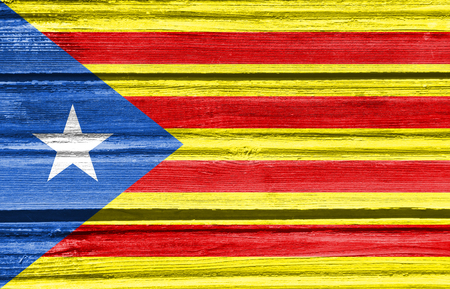 Catalonia flag. Grunge distress texture. Old wood
