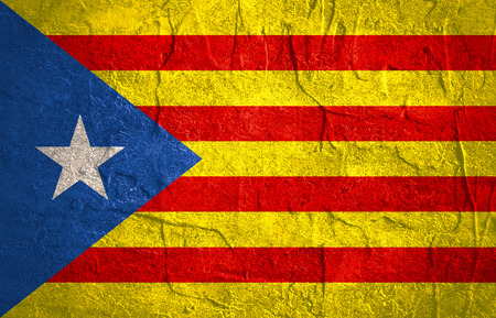 Catalonia flag. Grunge distress texture. Concrete wall