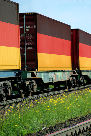 freight train: Train Freight transportation. Cargo transit. Summer Day. Container textured by flag of the Germany