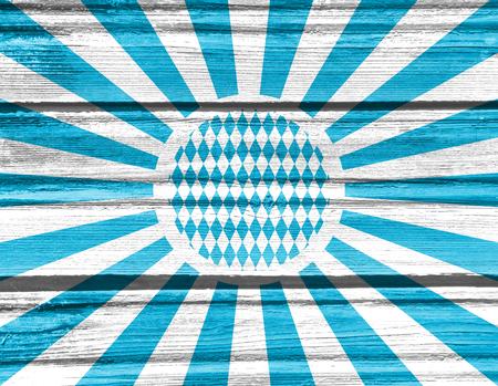Oktoberfest bavarian traditional blue and rhombus background pattern. Blue radial sun rays. Wood texture. Stock Photo