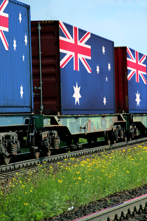 freight train: Train Freight transportation. Cargo transit. Summer Day. Container textured by flag of the Australia Stock Photo
